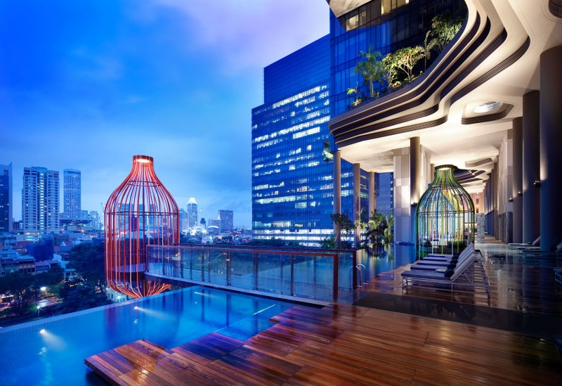 Glamour Park Royal Sky Garden Hotel With Outdoor Pool Near Wood Pool Deck Also Small Patio For Longue Area With Minimalist Longue Chairs
